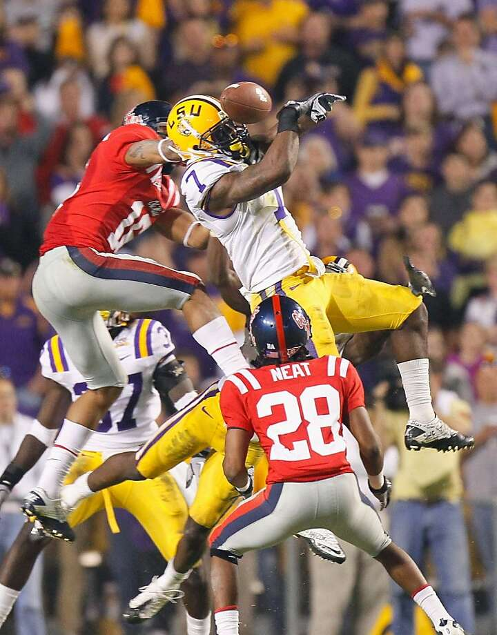 BATON ROUGE, LA - NOVEMBER 20:  Patrick Peterson #7 of the Louisiana State University Tigers nearly intercepts a pass in the final seconds against Markeith Summers #16 and Korvic Neat #28 of the Ole Miss Rebels as time expired at Tiger Stadium on November 20, 2010 in Baton Rouge, Louisiana.  (Photo by Kevin C. Cox/Getty Images) Photo: Kevin C. Cox, Getty Images