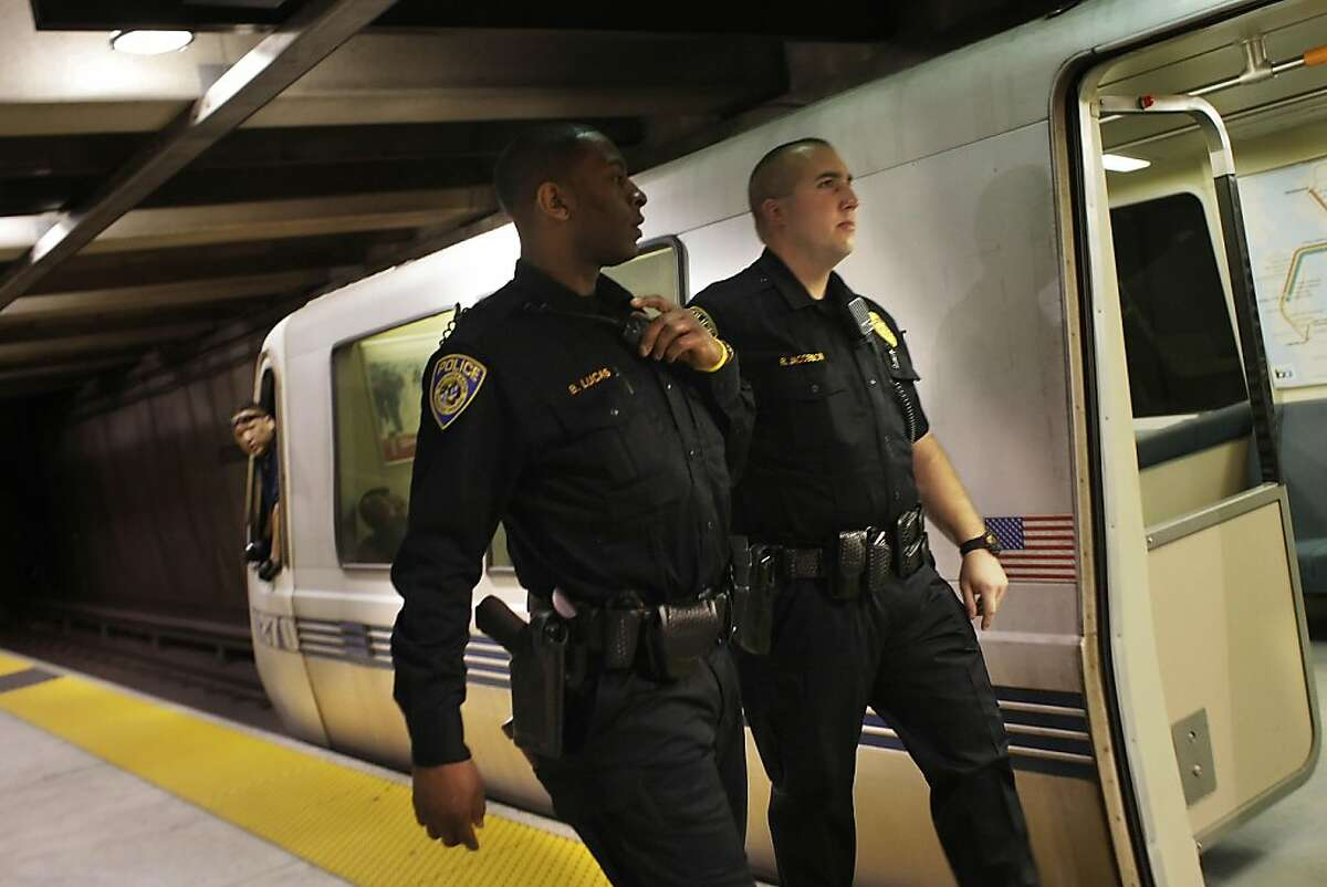 BART Police officers J. Barnes (l to r) and Richard Jacobson board a BART train while on patrol in Oakland, Calif., Monday, May 2, 2011.