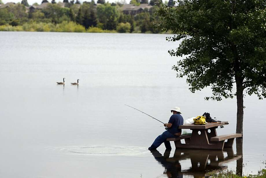 Larry Berteram of Santa Clara doesn't mind the high water line while he fishes for trout inside Horseshoe Lake at Quarry Lakes Regional Recreation Area in Fremont, Calif., on Saturday, April 23, 2011. Photo: Thomas Levinson, The Chronicle