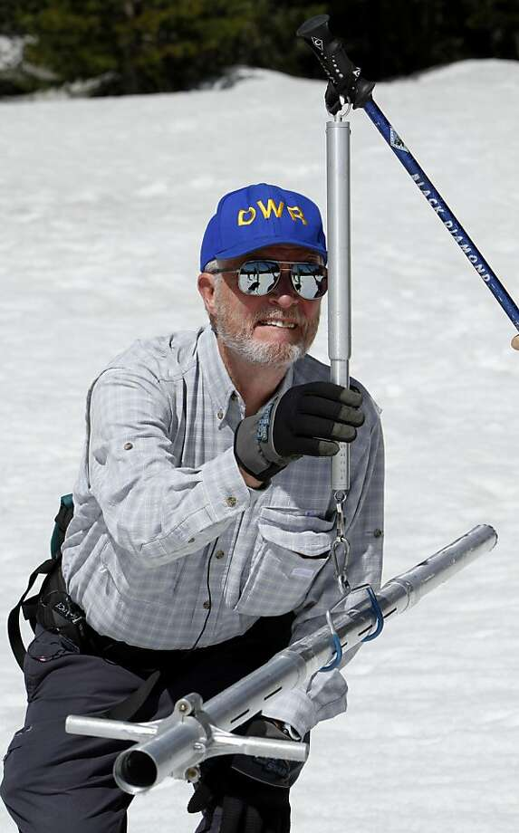 Frank Gehrke,  chief of snow surveys for the Department of Water Resources,  checks the weight of a snow sample on a scale during the snow survey at Echo Summit Calif.,  Monday, May 2, 2011. The final snow survey of the season found the snow pack to be 66inches deep, with a water content of 33.7 inches which is about 209 percent of normal at this location for this time of the year. Photo: Rich Pedroncelli, AP