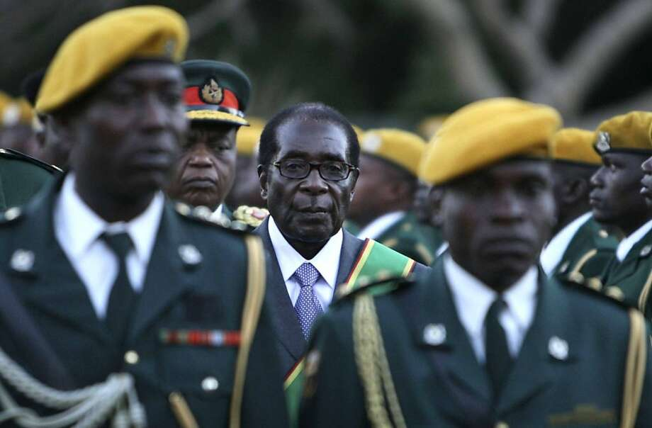 ** FOR USE AS DESIRED WITH YEAR END--FILE **In this June 29, 2008 file photo, Zimbabwean President Robert Mugabe at his inauguration ceremony at State house in Harare. (AP Photo/Tsvangirayi Mukwazhi/FILE) Photo: Tsvangirayi Mukwazhi, AP