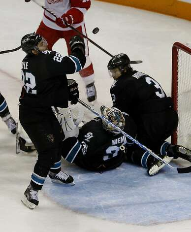 The Sharks' Dan Boyle (22) bats away a goal attempt in the third period against the Detroit Red Wings in game two of the Western Conference semifinals at HP Pavilion on Sunday. Photo: Brant Ward, The Chronicle