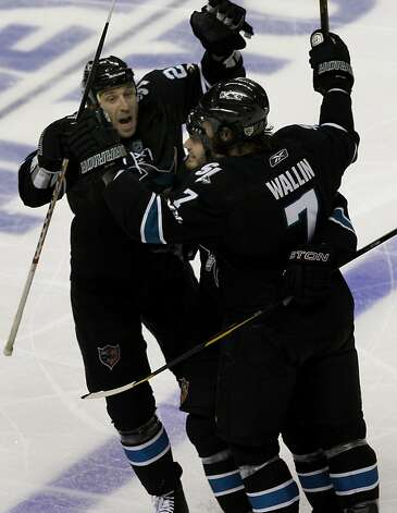 The Sharks' Ryane Clowe (left) greets Niclas Wallin after Wallin's third period goal against the Detroit Red Wings in game two of the Western Conference semifinals at HP Pavilion on Sunday. Photo: Brant Ward, The Chronicle