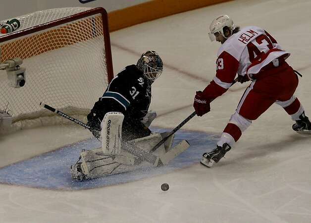 Sharks goalie Antti Niemi defends a shot by Darren Helm of the Red Wings in the second period of game two of the Western Conference semifinals at HP Pavilion on Sunday. Photo: Brant Ward, The Chronicle