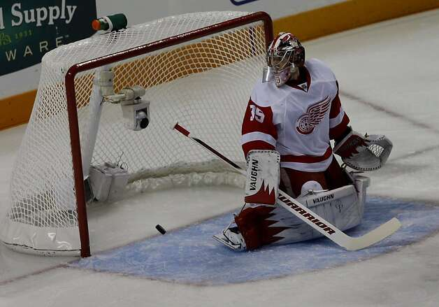 Detroit goalie Jimmy Howard watches a shot by Ian White of the Sharks go by him on a power play in the first period of game two of the Western Conference semifinals at HP Pavilion on Sunday. Photo: Brant Ward, The Chronicle