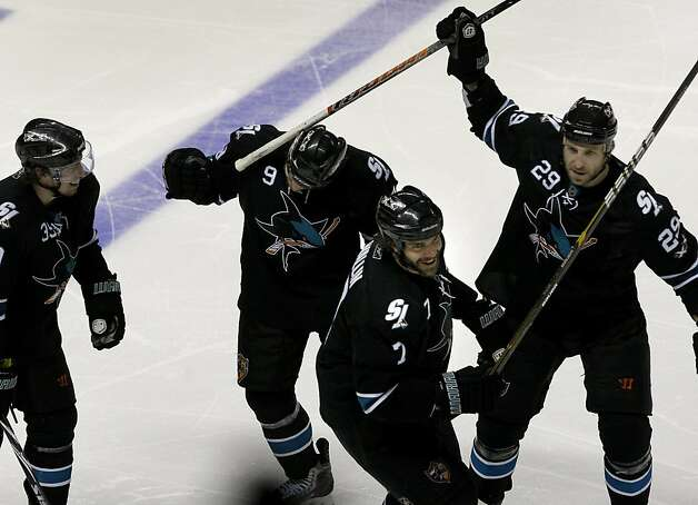 The Sharks' Niclas Wallin (third from left) and teammates celebrate Wallin's third period goal against the Detroit Red Wings in game two of the Western Conference semifinals at HP Pavilion on Sunday. Photo: Brant Ward, The Chronicle