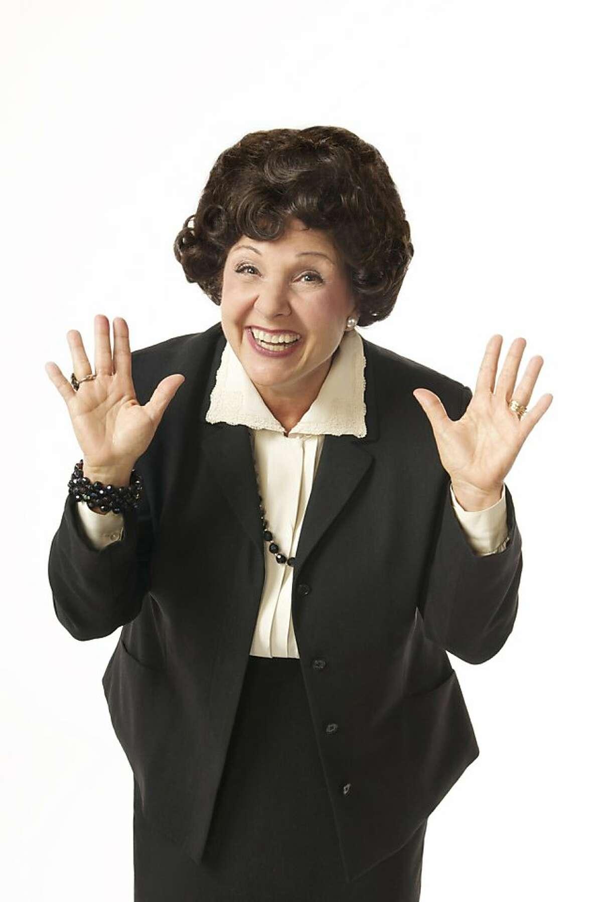 Kerri Shawn plays Ann Landers in