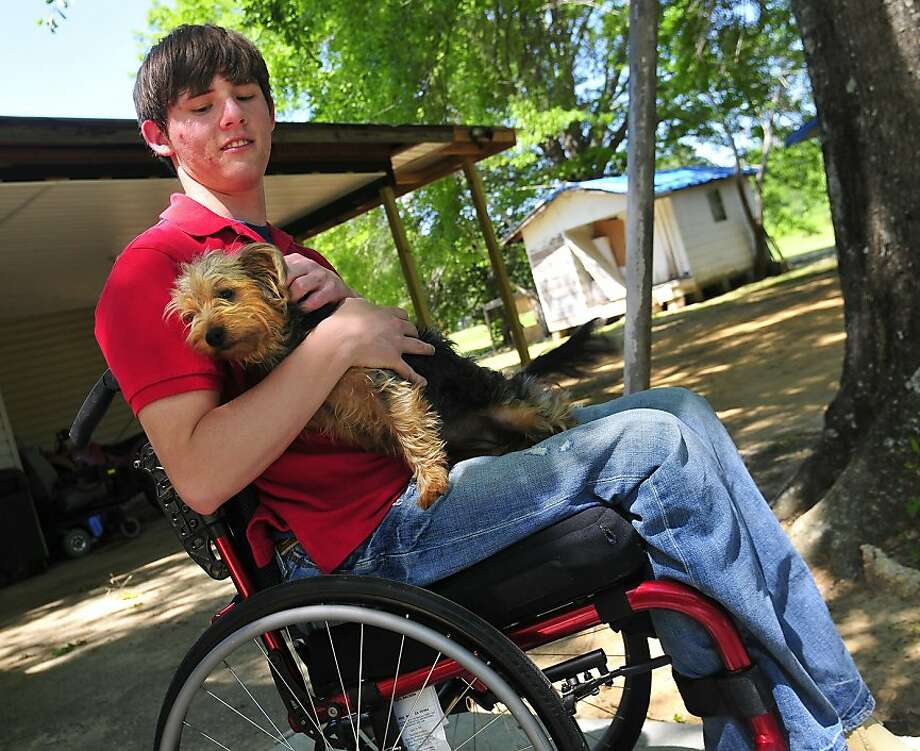 Timothy Atchison sits with his Yorkshire Terrier Lily outside his home in Chatom, Ala. Atchison, 21, who was paralyzed in a car crash in 2010, has identified himself as the volunteer who was treated by researchers with human embryonic stem cells. Illustrates STEMCELLS (category a) by Rob Stein, © 2011 The Washington Post. Moved Friday, April 15, 2011. (MUST CREDIT: Photo by David Bundy for The Washington Post.) Photo: Post, THE WASHINGTON POST