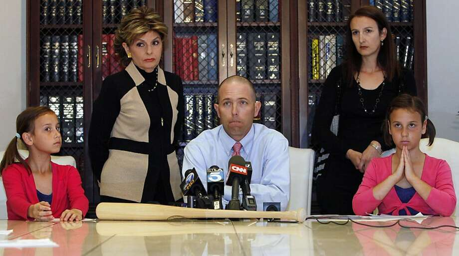 Justin Quinn, center, with his wife Jessica, right, and their twin daughters: Kylynn, far left, and Taylor, far right, take questions during a news conference organized by Los Angeles attorney Gloria Allred, standing left,  on Wednesday, April 27, 2011, in Los Angeles. Quinn claims Atlanta Braves pitching coach Roger McDowell made homophobic comments and crude sexual gestures toward fans and threatened him with a bat before the Braves played the San Francisco Giants on April 23. Photo: Damian Dovarganes, AP