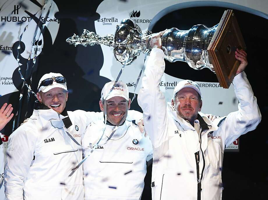 VALENCIA, SPAIN - FEBRUARY 14: (L-R) Oracle's helmsman, James Spithill of Australia, BMW Oracle Racing CEO and skipper Russell Coutts of New Zealand, and Oracle Corporation CEO Larry Ellison celebrate after the second race of the 33rd America's Cup off Valencia's coast on February 14, 2010 in Valencia, Spain. Photo: Manuel Queimadelos Alonso, Getty Images