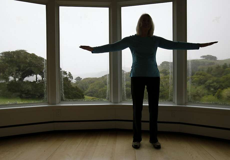 When it rains, Gina Thompson practices Qigong near a window overlooking her property Tuesday March 15, 2011. Gina Thompson, 73, practices Qigong, a slow form of Tai Chi, every morning at her Nicasio, Calif. home. Photo: Brant Ward, The Chronicle