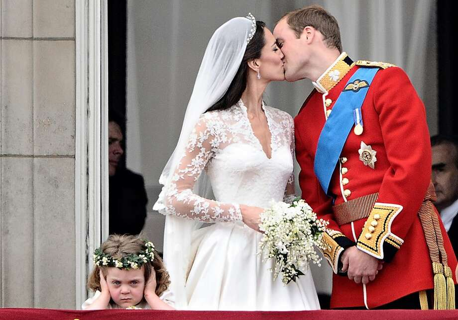 Britain's Prince William kisses his wife Kate, Duchess of Cambridge, on the balcony of Buckingham Palace, after their wedding service, on April 29, 2011, in London. Photo: Leon Neal, AFP/Getty Images