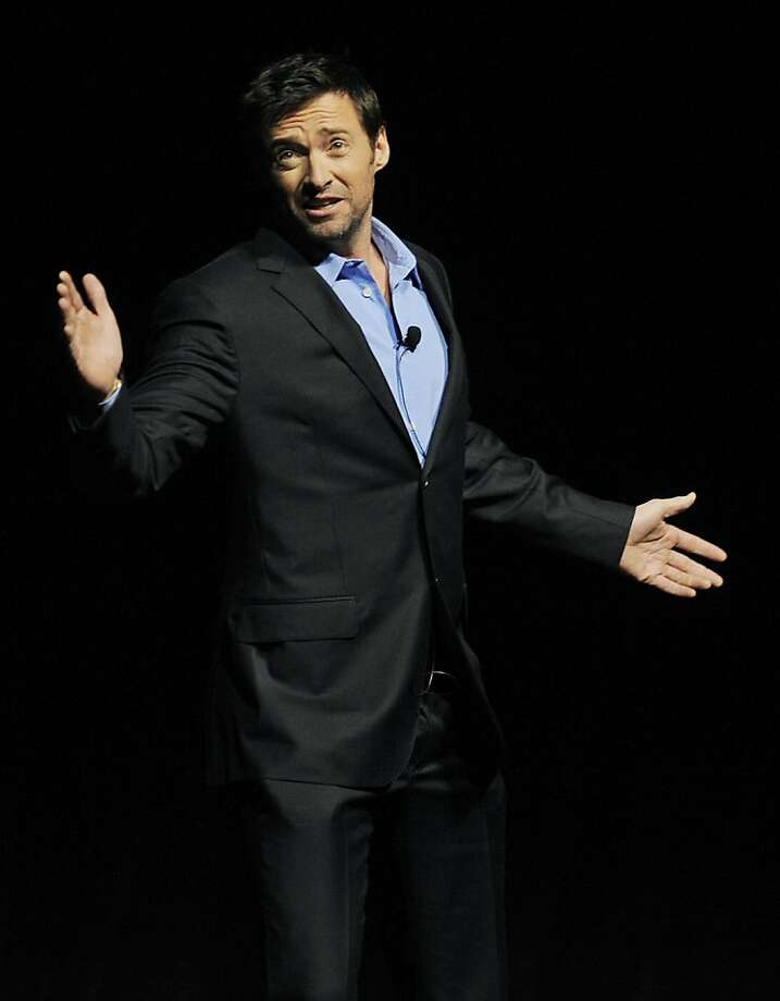 "Hugh Jackman, star of the upcoming film ""Real Steel,"" strikes a theatrical pose as he addresses the audience during the ""State of the Industry"" event at CinemaCon 2011, the official convention of the National Association of Theater Owners, Tuesday, March29, 2011, in Las Vegas. Photo: Chris Pizzello, AP"