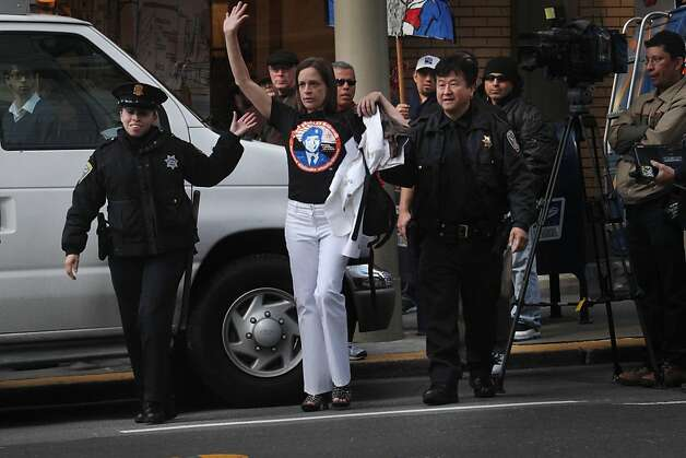 Naomi Pitcairn of Oakland is detained on Third Street after protesting and leaving a fundraiser at the St. Regis in San Francisco, Calif., Thursday, April 21, 2011. Photo: Lea Suzuki, The Chronicle
