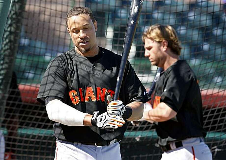 The Giants Emmanuel Burriss (left) passed Kevin Frandsen at batting practice Tuesday February 23, 2010. Scenes from the San Francisco Giants and Oakland Athletics spring training campaigns of 2010 in Scottsdale and Phoenix, Arizona. Photo: Brant Ward, The Chronicle