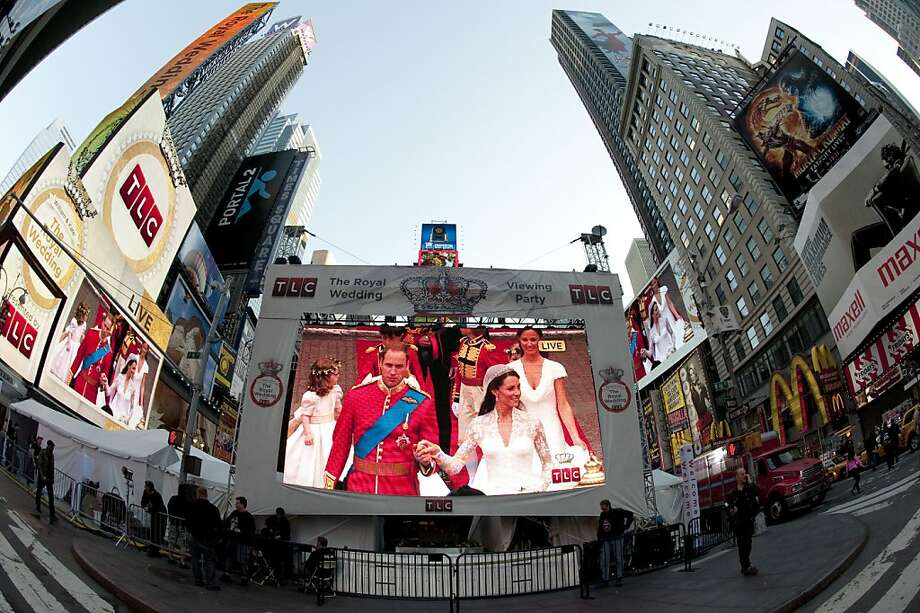 The Royal wedding is seen on the big screen April 29, 2011 at Times Square in New York.  The fairytale wedding of Prince William and Kate Middleton captured the imagination of the world Friday, with millions sharing in the celebration of the royal nuptials at parties across the globe.An estimated two billion people watched on TV when William and Kate exchanged vows at Westminster Abbey, and even in the home to the Hollywood stars royal glamour shined strong. Photo: Don Emmert, AFP/Getty Images