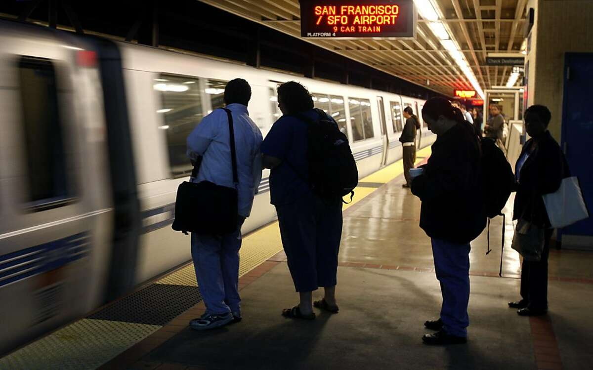 Commuters wait to board a San Francisco-bound train at the MacArthur BART station in Oakland, Calif., on Friday, Sept. 4, 2009, the first full day the Bay Bridge is shut down to replace a section of the eastern span.