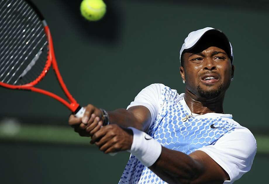FILE - This March 12, 2011, file photo shows Donald Young making a return against Andy Murray during their match at the BNP Paribas Open tennis tournament, in Indian Wells, Calif.  Offended by Young's expletive-laden rip on the USTA via Twitter, Patrick McEnroe responded Monday April 25, 2011, with a pointed comeback of his own, saying the 21-year-old would need to apologize before the USTA did anything more to support him. Photo: Mark J. Terrill, AP