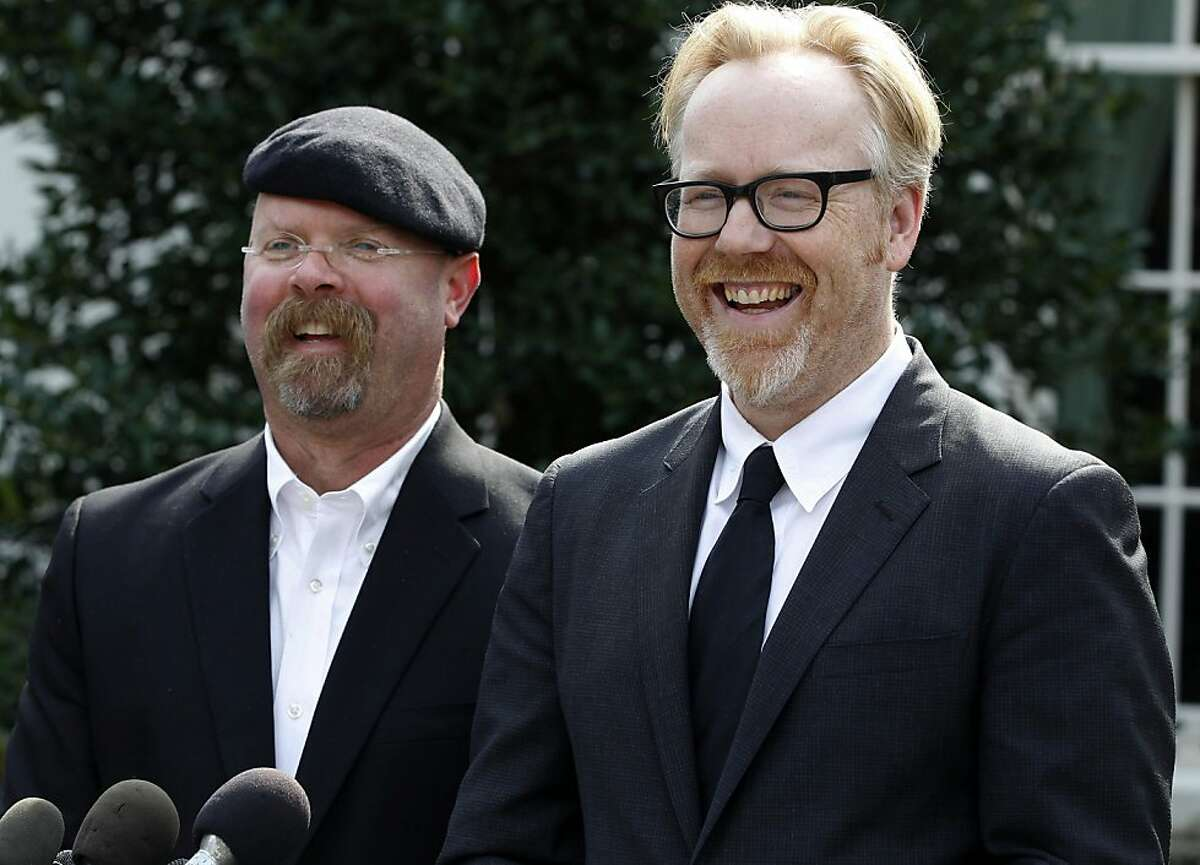 FILE - Discovery Channel's MythBusters hosts, Jamie Hyneman, left, and Adam Savage, speak to reporters outside the White House in Washington, Monday, Oct. 18, 2010, after they taped a segment with President Barack Obama. Sheriff's deputies Wednesday were still trying to measure how a cannonball fired near a suburban neighborhood for an episode of the show rocketed through the front door of a home, through its master bedroom, and landed in a neighbor's parked minivan. (AP Photo/Charles Dharapak)