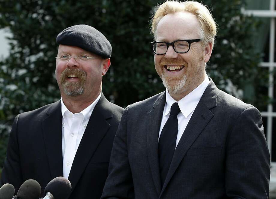 FILE - Discovery Channel's MythBusters hosts, Jamie Hyneman, left, and Adam Savage, speak to reporters outside the White House in Washington, Monday, Oct. 18, 2010, after they taped a segment with President Barack Obama. Sheriff's deputies Wednesday were still trying to measure how a cannonball fired near a suburban neighborhood for an episode of the show rocketed through the front door of a home, through its master bedroom, and landed in a neighbor's parked minivan. (AP Photo/Charles Dharapak) Photo: Charles Dharapak, AP