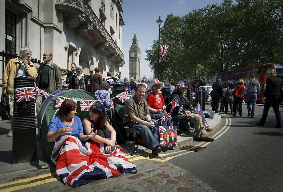 Royal enthusiasts camp in front of Westminster Abbey in London, Thursday, April 28, 2011. Revelers are camping outside the Abbey where Prince William and Kate Middleton are due to get married on Friday, April 29. (AP Photo/Daniel Ochoa de Olza) Photo: Daniel Ochoa De Olza, AP