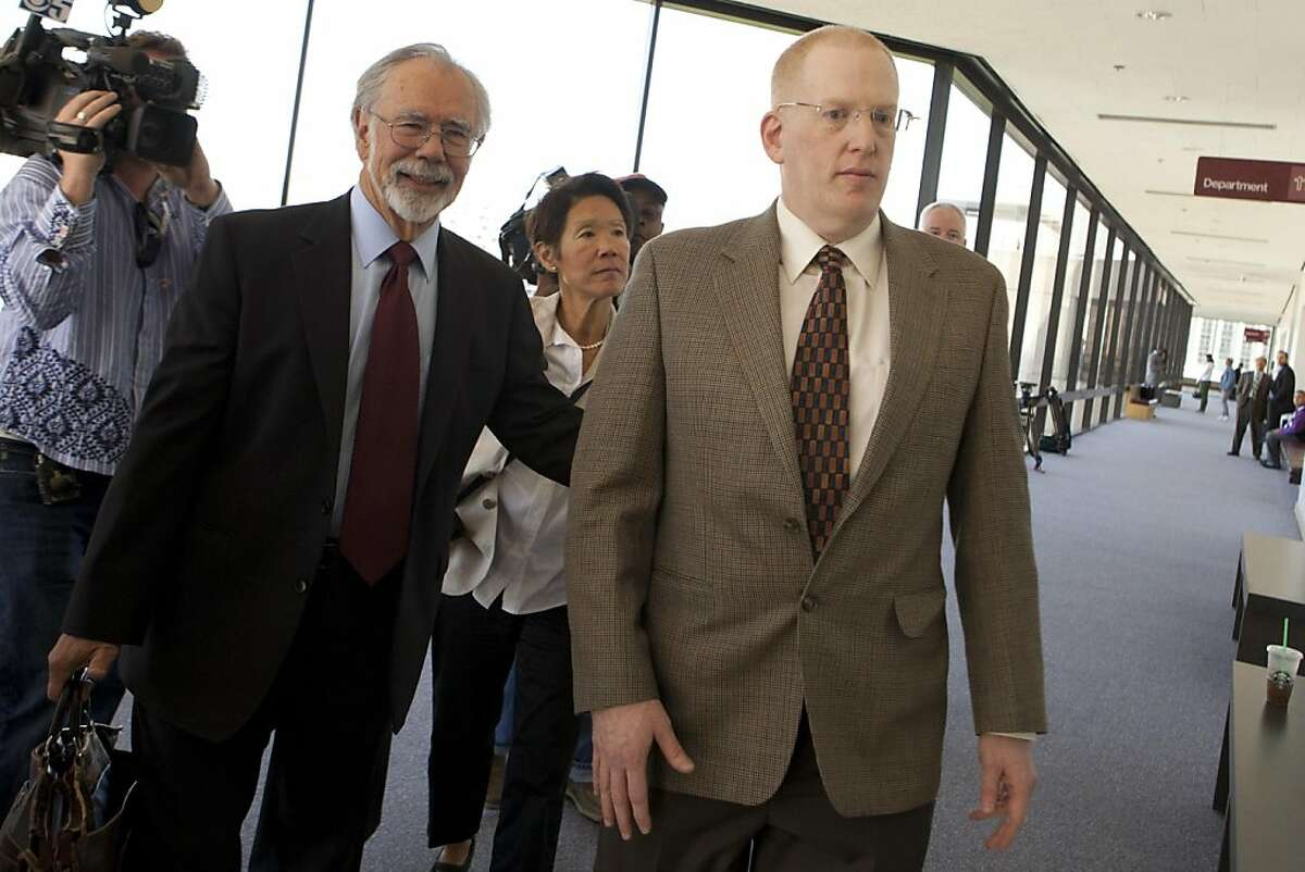 From left, Defense attorney Robert Beles, an unidentified woman and Robert Kevess walk to department 112 of the Alameda COunty Court House in Oakland, Calif. on Thursday, April 28, 2011 where Kevess is being arraigned on charges of sexually assaulting numerous male patients while working at UC Berkeley's student health center. Kat Wade / Special to the Chronicle