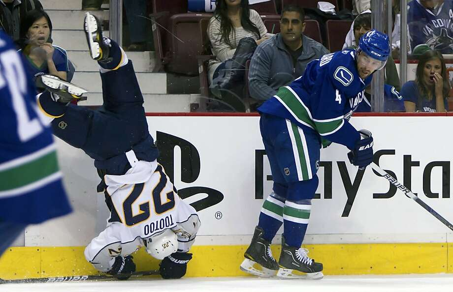 Vancouver Canucks' Keith Ballard, right, checks Nashville Predators' Jordin Tootoo during the second period of Game 1 in their NHL Western Conference semi-final Stanley Cup playoff hockey series in Vancouver, British Columbia, Thursday, April 28, 2011. Ballard received a clipping penalty on the play. Photo: Darryl Dyck, AP