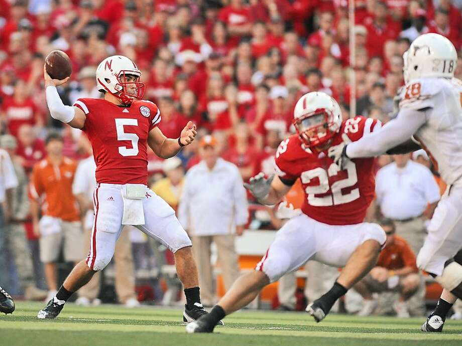 LINCOLN, NE - OCTOBER 16: Quarterback Zac Lee #5 of the Nebraska Cornhuskers throws downfield as teammate Rex Burkhead blocks during their game at Memorial Stadium on October 16, 2010 in Lincoln, Nebraska. Texas Defeated Nebraska 20-13. (Photo by Eric Francis/Getty Images) Photo: Eric Francis, Getty Images