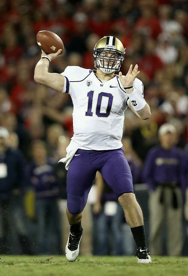 TUCSON, AZ - OCTOBER 23:  Quarterback Jake Locker #10 of the Washington Huskies throws a pass during the college football game against the Arizona Wildcats at Arizona Stadium on October 23, 2010 in Tucson, Arizona. Photo: Christian Petersen, Getty Images
