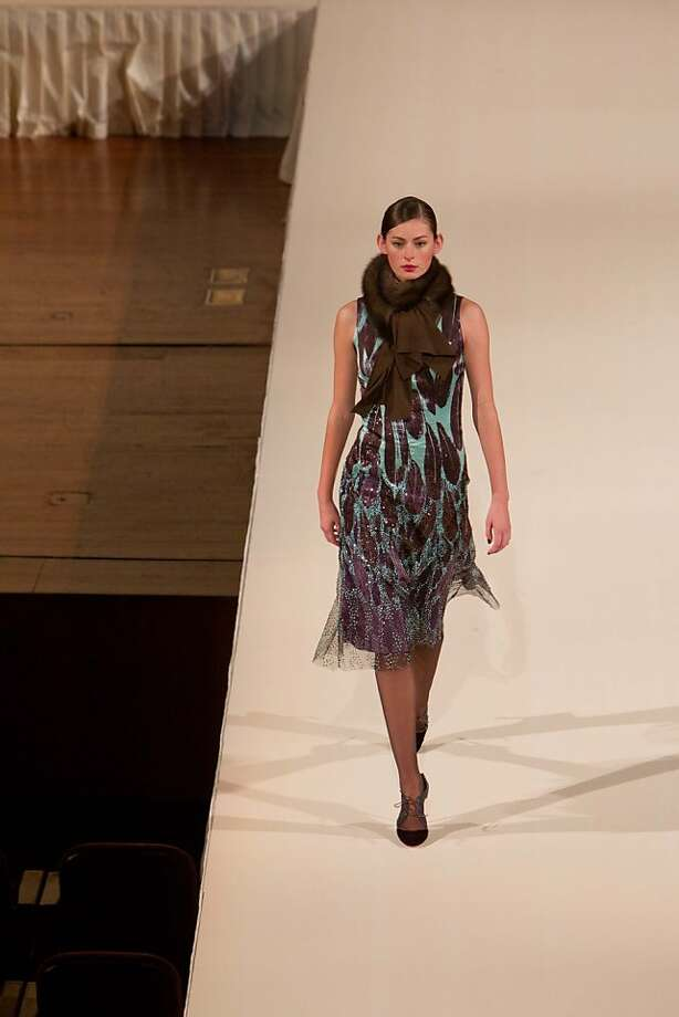 For the San Francisco Symphony's 100th anniversary, a fundraising fashion show and dinner was held at Davies Symphony Hall on April 20, 2011, with designer Carolina Herrera as guest of honor. On the runway, Carolina Herrera's fall 2011 collection was shown. Here, we see a model in Turquoise feather print silk cr?pe and wool double face dress, amethyst mink knit scarf and amethyst velvet belt. Photo: Drew Altizer Photography