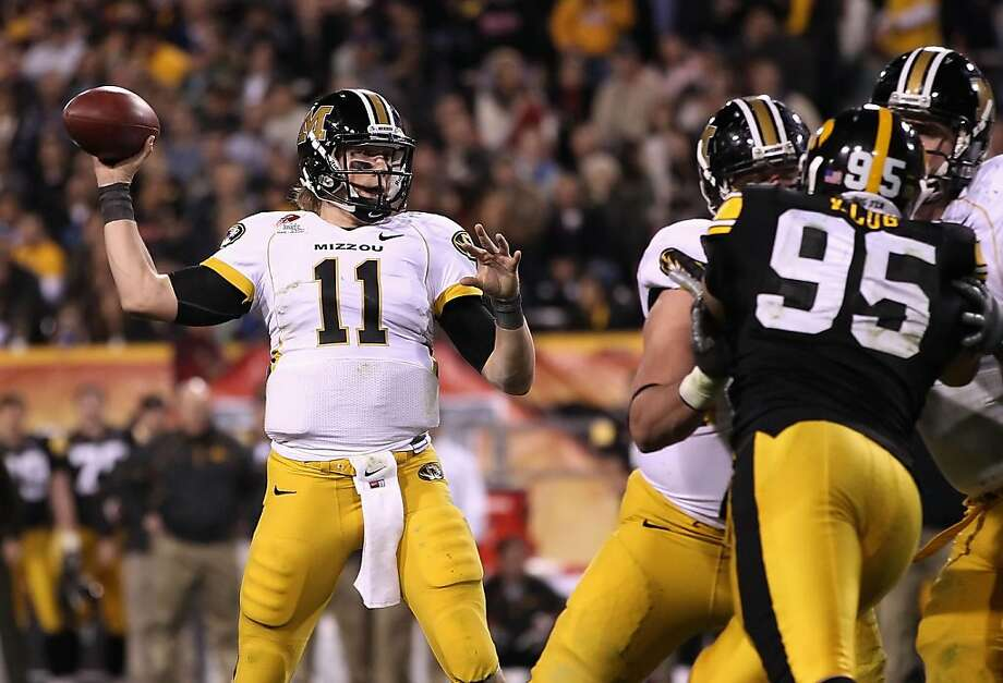 TEMPE, AZ - DECEMBER 28:  Quarterback Blaine Gabbert #11 of the Missouri Tigers drops back to pass during the Insight Bowl against the Iowa Hawkeyes  at Sun Devil Stadium on December 28, 2010 in Tempe, Arizona.  The Hawkeyes defeated the Tigers 27-24.  (Photo by Christian Petersen/Getty Images) Photo: Christian Petersen, Getty Images