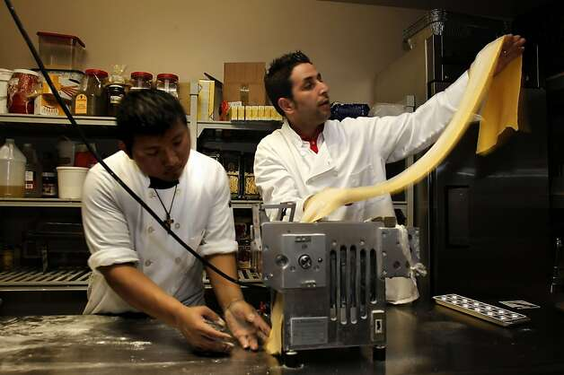 Pasta maker, Jesus Castrochan, (left) and the owner of Vicoletto Restaurant and Wine bar, Francesco Covucci, prepare their tagliatelle pasta, on Thursday April 28, 2011, which will be a featured dish during the noodle fest. 17 North Beach restaurants and 17 Chinatown restaurants are joining together this Sunday for Noodle Fest, with the goal of boosting business for the two very different neighborhoods. Photo: Michael Macor, The Chronicle