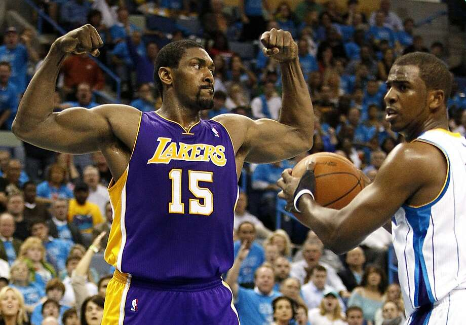 Los Angeles Lakers forward Ron Artest (15) reacts in front of New Orleans Hornets point guard Chris Paul after scoring during the second half of Game 6 of a first-round NBA basketball playoff series in New Orleans, Thursday, April 28, 2011. Los Angeles  defeated New Orleans 98-80 to advance to the next round. Photo: Patrick Semansky, AP