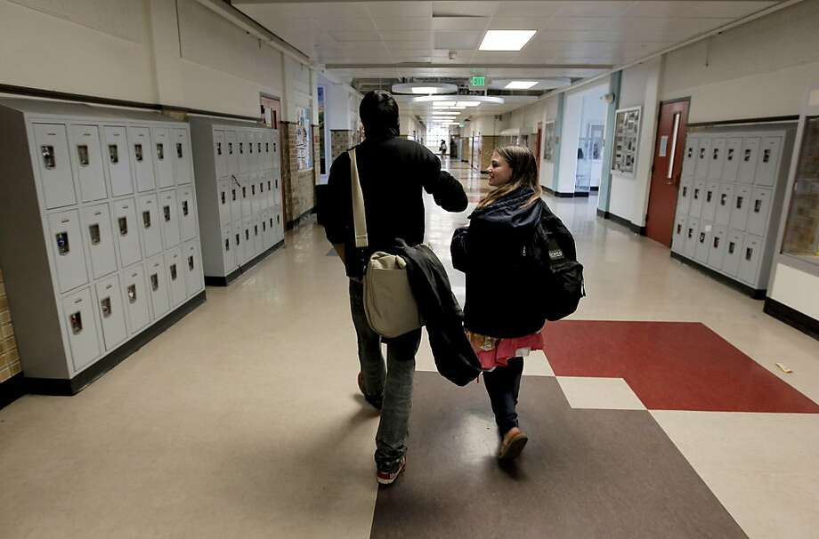 Anwar, and close friend Zoe Oppenheim, walk the halls of Berkeley High School, after his talk to a 12th grade Baccalaureate History 2 class at Berkeley High School, on Tuesday March 15, 2011, in Berkeley, Ca. Berkeley City College student Anwar, a native of Afgfhanistan, risked his life last year to get a visa to come here to study. Photo: Michael Macor, The Chronicle