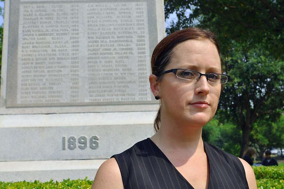 In this April 20, 2011 photo, Nikki Araguz stands in front of a monument to fallen volunteer firefighters in Austin, Texas. Araguz is a transgendered woman whose husband died while fighting a fire in Wharton County in 2010, and she now faces a lawsuit claiming her marriage was not valid. Two Texas lawmakers have introduced legislation that would repeal a state law that recognized transgender marriages in 2009. Photo: Chris Tomlinson, AP