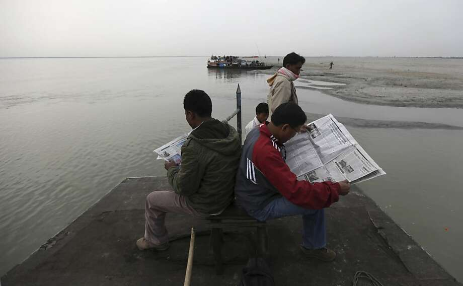 In this Feb. 21, 2011 photo, people read newspapers as they travel on a ferry in Brahmaputra river near Bahir Jonai, Assam, India. A vast and heavily populated region of Asia that depends on water from Tibetan rivers is feeling the effects of China's ambitious efforts to redraw its water map. Some even worry about future water wars; others say there's still time for diplomacy to keep the peace. Photo: Altaf Qadri, AP