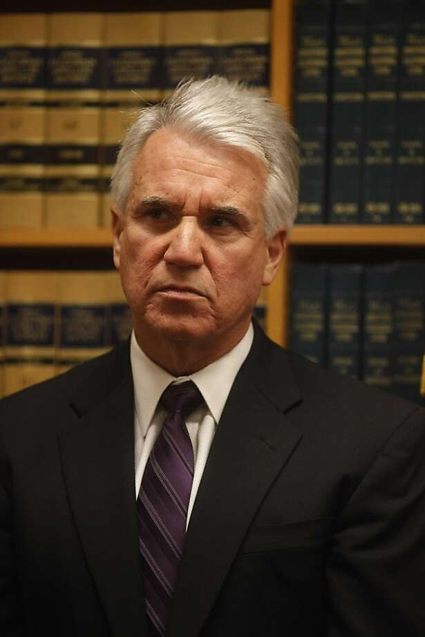 Walking out his office at the Hall of Justice, District Attorney George Gascon speaks at a press conference about charges made to a former funeral home operator for misappropriating funds on Monday Feb. 14, 2011 in San Francisco, Calif. Photo: Mike Kepka, The Chronicle