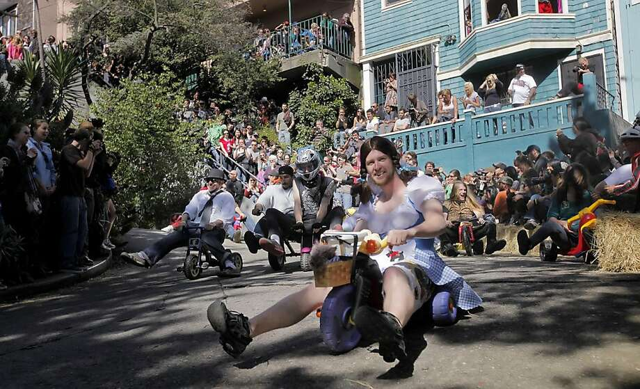 """Races speed down the crooked part of Vermont Streets in the eleventh annual Easter Day """"Bring Your Own Big Wheel Race"""", Sunday April 24, 2011, in San Francisco, Calif. Photo: Lacy Atkins, The Chronicle"""