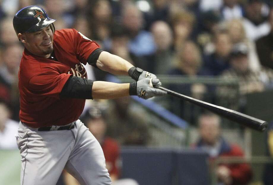 Houston Astros' Humberto Quintero hits a two-run scoring double during the 10th inning of a baseball game against the Milwaukee Brewers, Saturday, April 23, 2011, in Milwaukee. Photo: Morry Gash, AP
