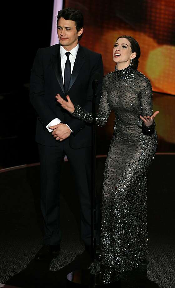 Actors James Franco (L) and Anne Hathaway present the 83rd Annual Academy Awards at the Kodak Theatre late on February 27, 2011 in Hollywood, California. Photo: Gabriel Bouys, AFP/Getty Images