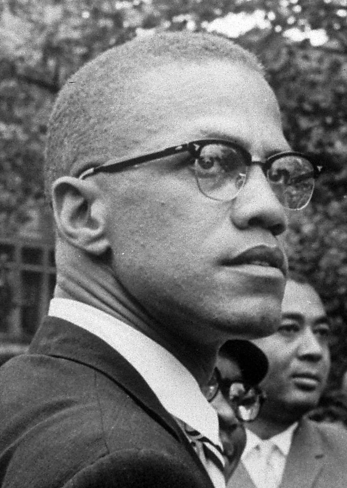 In this 1963 file photo, Black Nationalist leader Malcolm X is pictured at a rally at Lennox Avenue and 115th St., in the Harlem section of New York. The only man to admit shooting Malcolm X has been freed on parole, 45 years after he helped assassinate the civil rights leader in New York City. State Department of Correctional Services spokeswoman Linda Foglia says Thomas Hagan was freed Tuesday, April 27, 2010.