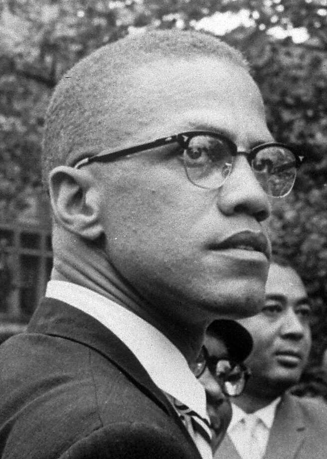In this 1963 file photo, Black Nationalist leader Malcolm X is pictured at a rally at Lennox Avenue and 115th St., in the Harlem section of New York. The only man to admit shooting Malcolm X has been freed on parole, 45 years after he helped assassinate the civil rights leader in New York City. State Department of Correctional Services spokeswoman Linda Foglia says Thomas Hagan was freed Tuesday, April 27, 2010. Photo: Robert Haggins, AP