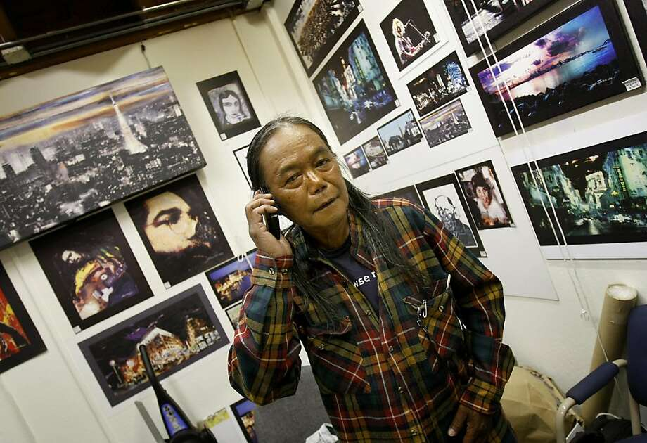 Archa Barcha inside the tiny artist studio he may have to vacate with some recent work on the wall. Archa Barcha is a former street artist in San Francisco, Calif. who has fallen on tough times and may become homeless soon if he cannot find buyers for his unique photographs, which have an oil painting-like quality. Photo: Brant Ward, The Chronicle