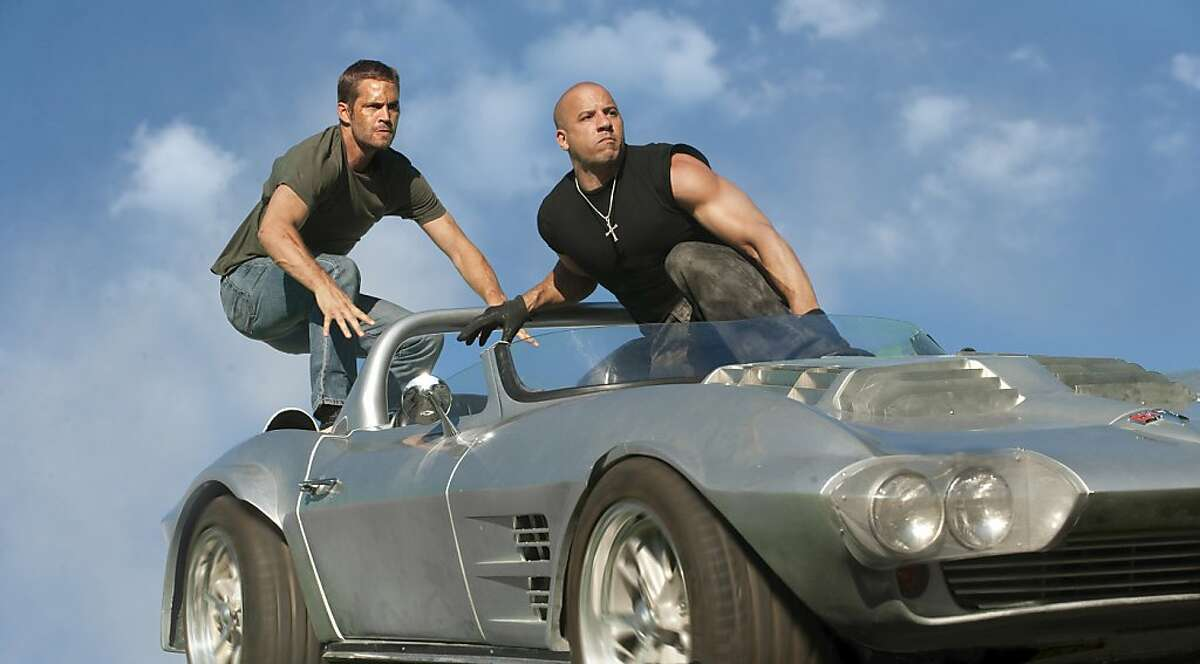 (L to R) Brian O'Conner (PAUL WALKER) and Dom Toretto (VIN DIESEL) in a reunion of returning all-stars from every chapter of the explosive franchise built on speed--