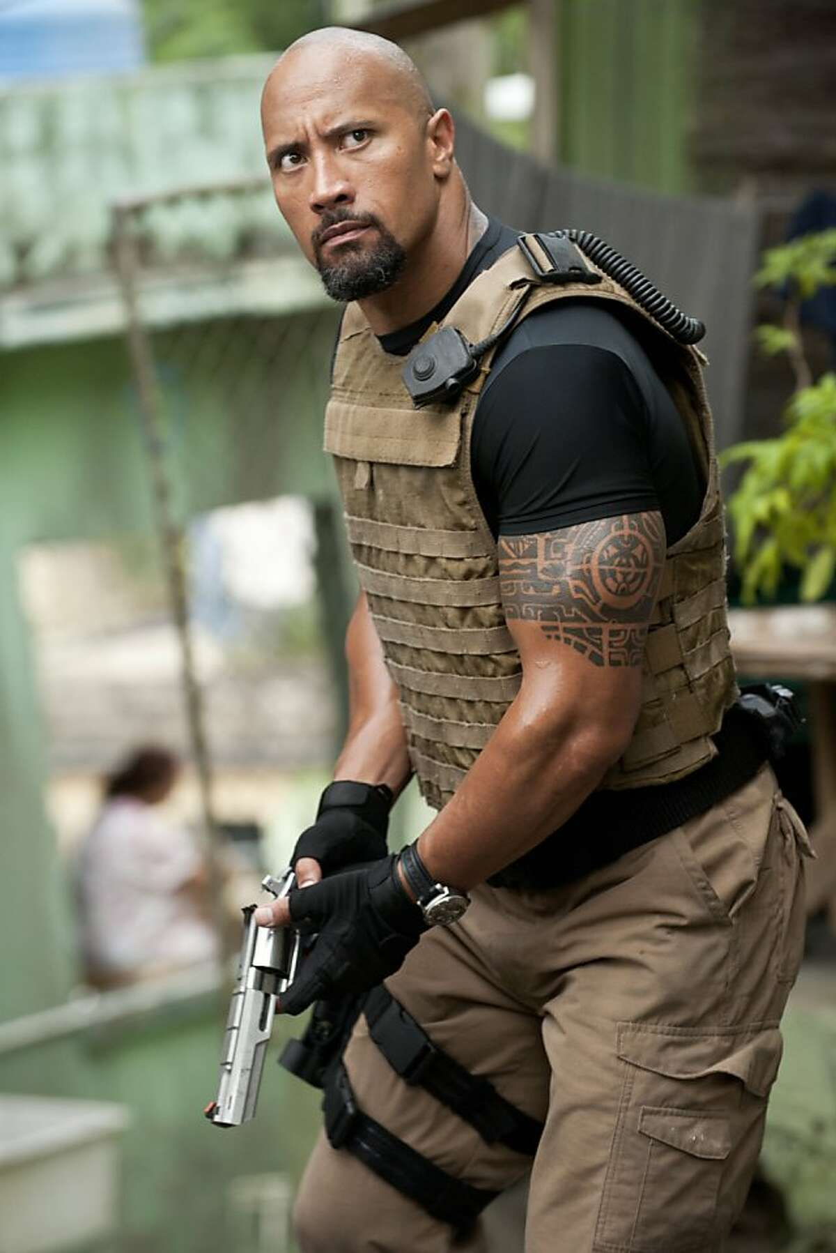 In this film publicity image released by Universal Pictures, Dwayne Johnson is shown in a scene from
