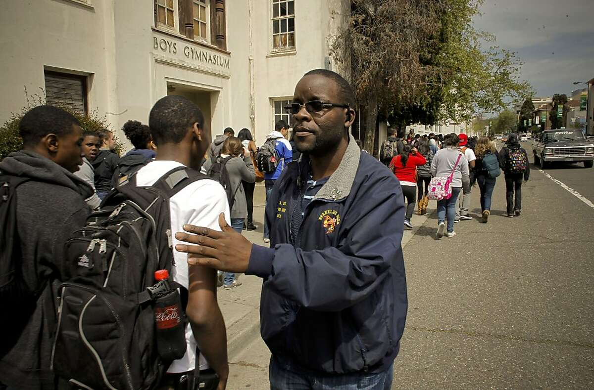 School Safety Officer, Billy Keys, keeps an eye on the students as they break for lunch at Berkeley High School on Thursday April 14, 2011, in Berkeley, Ca., where a rash of guns on campus have parents and the community on edge.