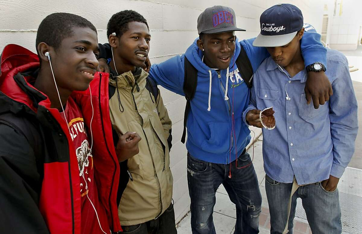 Students, (left to right) Brandon Taylor,, Jamil Whetstone, Mike Adams and Tyrone Carr, talk about gun issues on campus at Berkeley High School on Thursday April 14, 2011, in Berkeley, Ca., where a rash of guns on campus have parents and the community on edge.