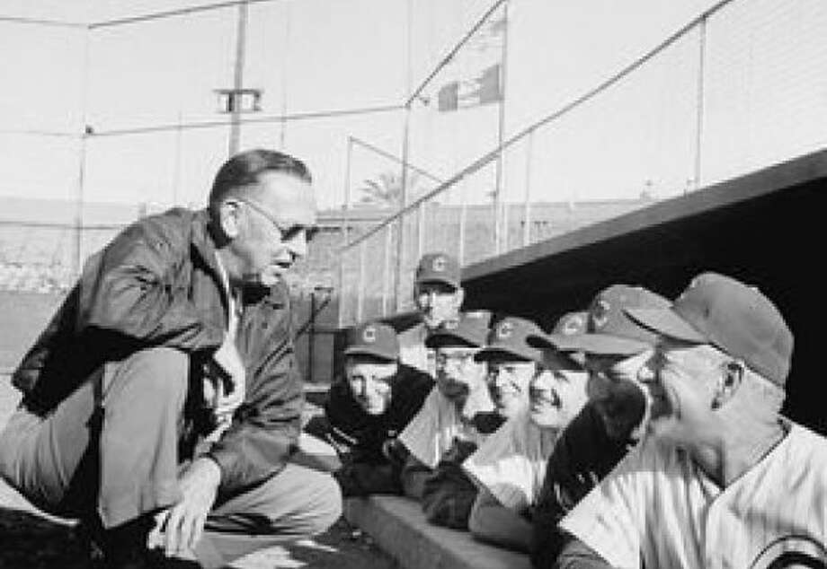Cubs owner Philip K. Wrigley with his coaches on his manager-less 1960s team. Photo: Mlb