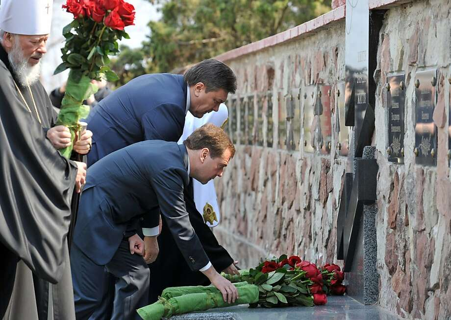 The head of the Ukrainian Orthodox Church Metropolitan Vladimir (L), Russian President Dmitry Medvedev (C) and Ukrainian President Viktor Yanukovych (R) lay flowers during a commemoration ceremony for Chernobyl Nuclear disaster in front of Chernobyl nuclear power plant, about 180 km north from Kiev, on April 26, 2011. The world on Tuesday marks a quarter century since the world's worst nuclear disaster at Chernobyl in Ukraine. Photo: Genya Savilov, AFP/Getty Images