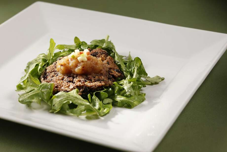 Black bean hazelnut patty and applesauce as seen in San Francisco, California, on Wednesday, April 13, 2011. Food styled by Lisa Appleton Photo: Craig Lee, Special To The Chronicle